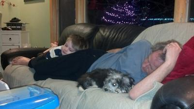 Teddy, my husband and grandson relaxing together on the couch.